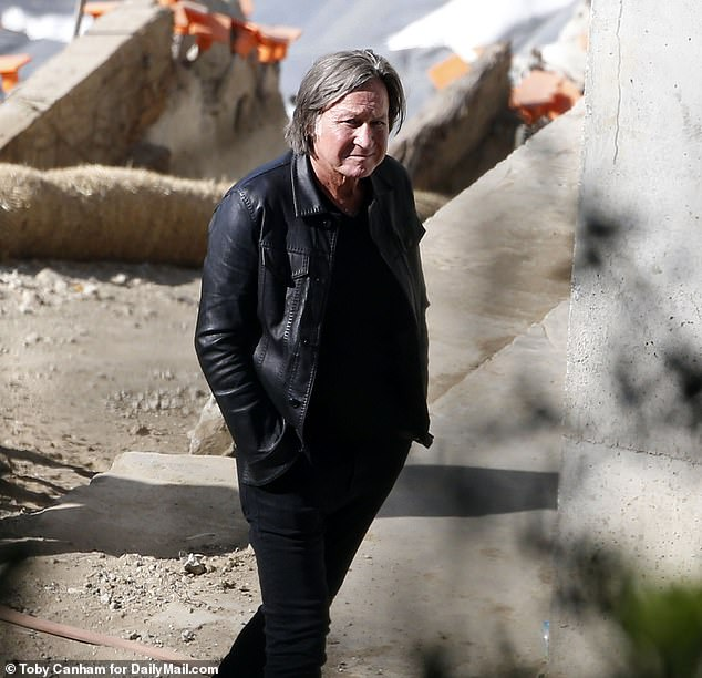 A glum looking Hadid, flanked by his two attorneys, was photographed following the judge around the property