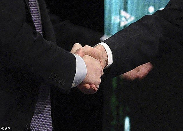 Boris Johnson and Jeremy Corbyn shook hands on stage at tonight's TV debate as they promised to restore trust in British politics