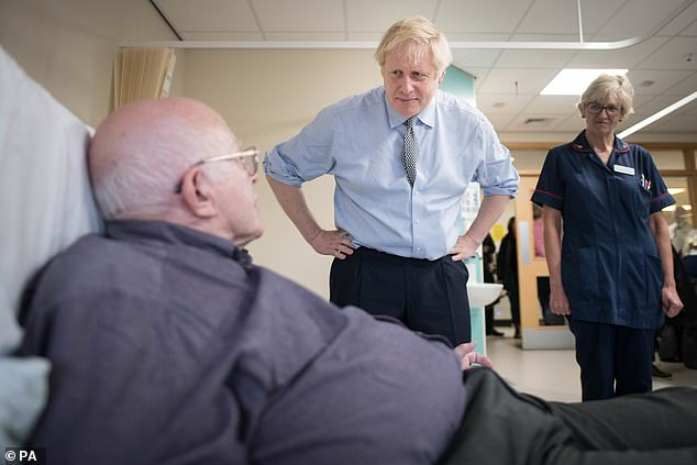 Boris Johnson (pictured on a hospital visit to Bassetlaw today) and Mr Corbyn will both run the gauntlet of the BBC Question Time audience tonight