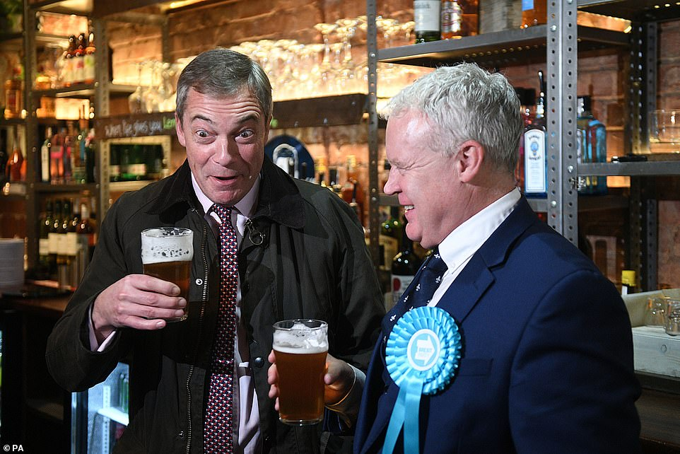 Nigel Farage was trying to keep his spirits up in Peterborough today as he joined Brexit Party candidate Mike Greene on the campaign trail . He said Julie Etchingam, the moderator of the debate, was the winner