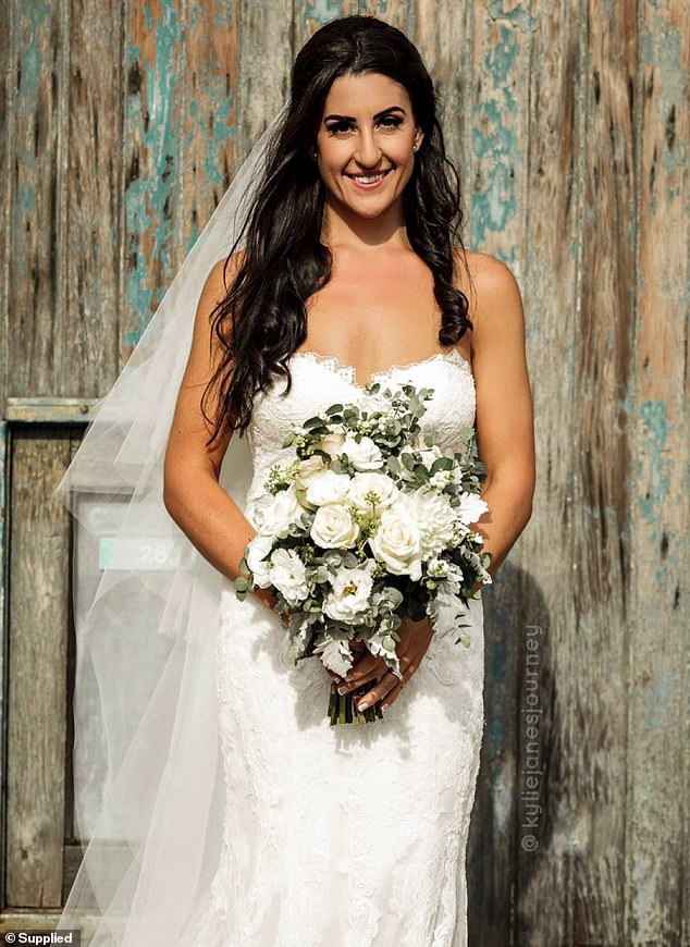 When she began visiting bridal shops in 2018 after shredding, her 65 kilo figure easily slipped into a size eight (pictured)