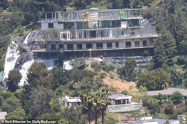 The 71-year-old is facing a civil lawsuit brought by angry neighbors who claim the half-finished project is not only an 'eyesore' and a 'monstrosity', but also a dangerously unstable hazard to their homes. Pictured: Hadid's home and his neighbors homes below it