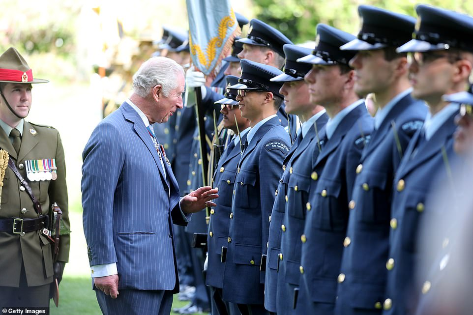 The Prince of Wales exchanges a few words with a New Zealand Air Force as he inspects troops at Government House in Auckland today