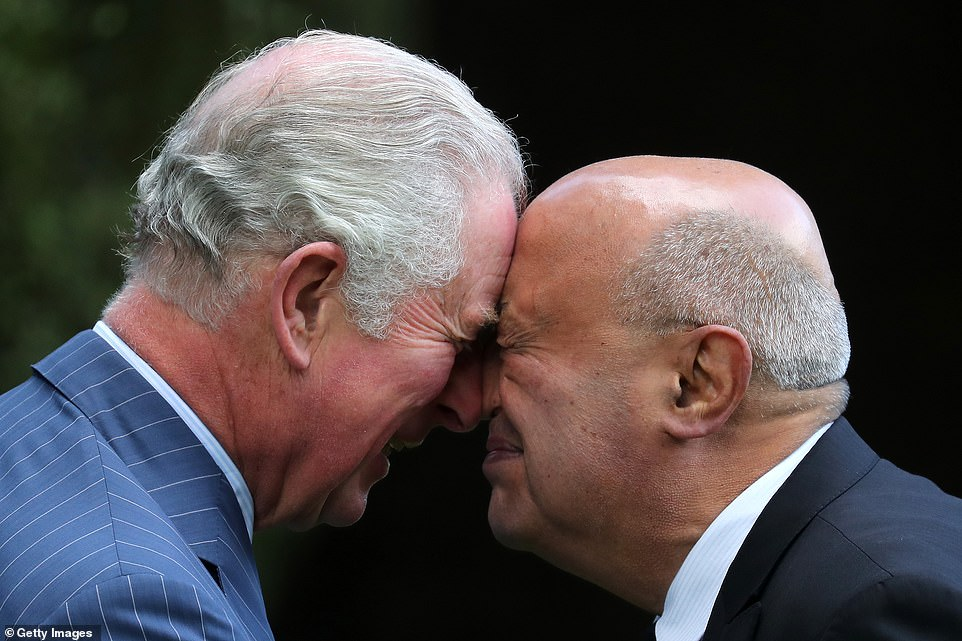 Prince Charles, Prince of Wales receives a Hongi, traditional Maori greeting, as he attends the Ceremony of Welcome, Government House in Auckland today