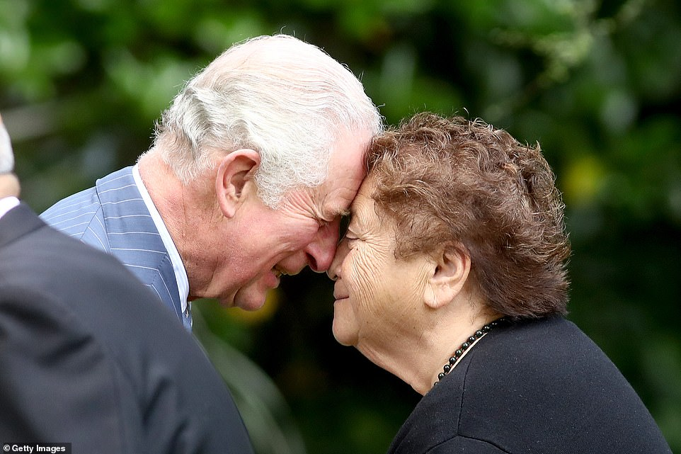 The Prince of Wales shares a traditional maori greeting of a hongi with Mrs Ranui Ngarimu at Government House in Auckland