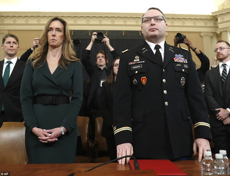 Jennifer Williams, an aide to Vice President Mike Pence, left, and Lt. Col. Alexander Vindman, kick off a week of testimony before the House Intelligence Committee on Capitol Hill Tuesday