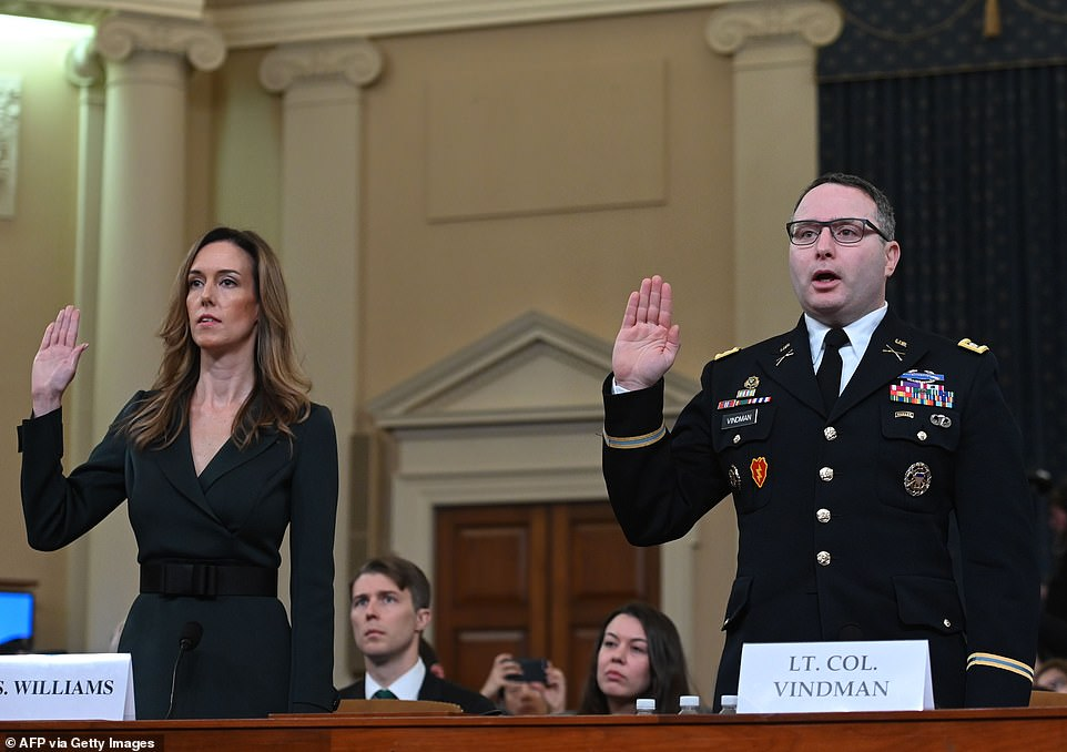 Colonel Alexander Vindman and Jennifer Williams take the oath before they testify during the House Intelligence Committee hearing into President Donald Trump's alleged efforts to tie US aid for Ukraine to investigations of his political opponents