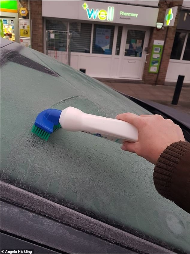 The thrifty motorist told how the handy brush attachment works as a scraper to help de-ice the car (pictured)