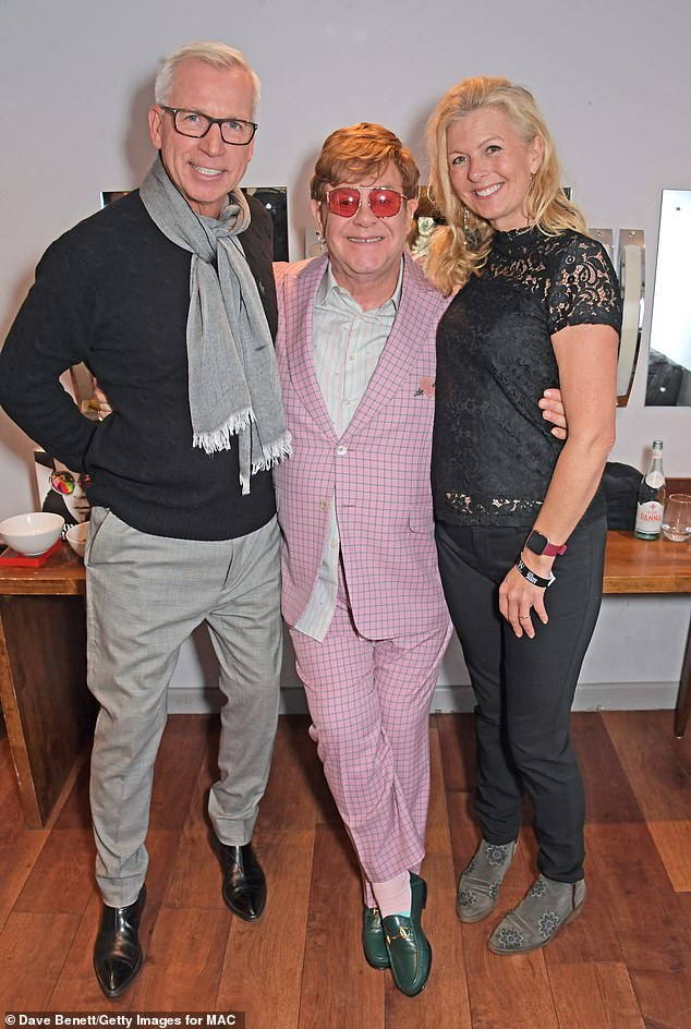 Beaming: Football manager Alan Pardew and his wife Tine were thrilled to meet the music superstar Elton, along