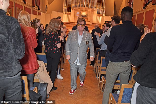 Off he goes: Maintaining his signature kooky style, the Your Song hitmaker paired a pale blue shirt with glossy red trainers
