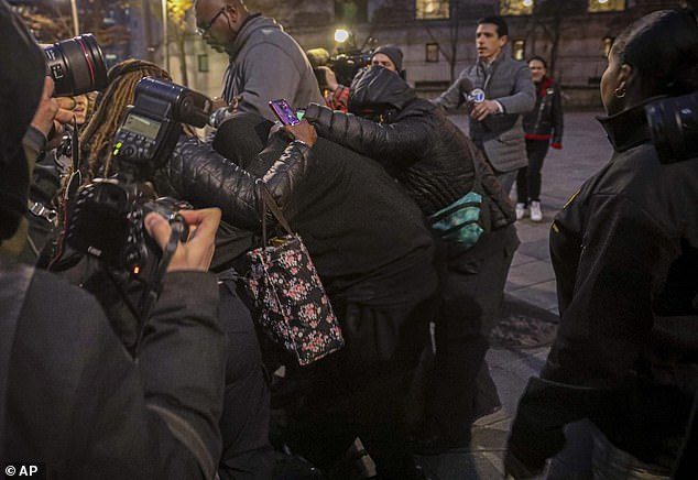 In an orchestrated plan, fellow officers formed a protective blockade to help shield them from photographers as they were released and left the court