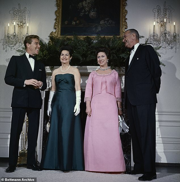 Pictured, left to right, Lord Snowdon, Mrs Johnson, Princess Margaret and President Johnson pose for photographers in the Queen's room at the White House during the visit in 1965