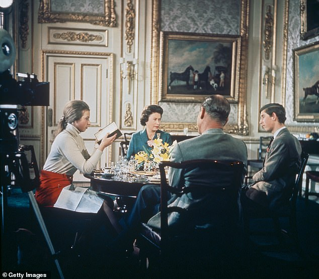 Titled Royal Family, the 1969 documentary was a combined effort between the BBC and ITV and covered a year in the life of the Queen. Pictured, the Queen, Prince Philip, Prince Charles and Princess Anne around the dining table of Windsor Castle during filming