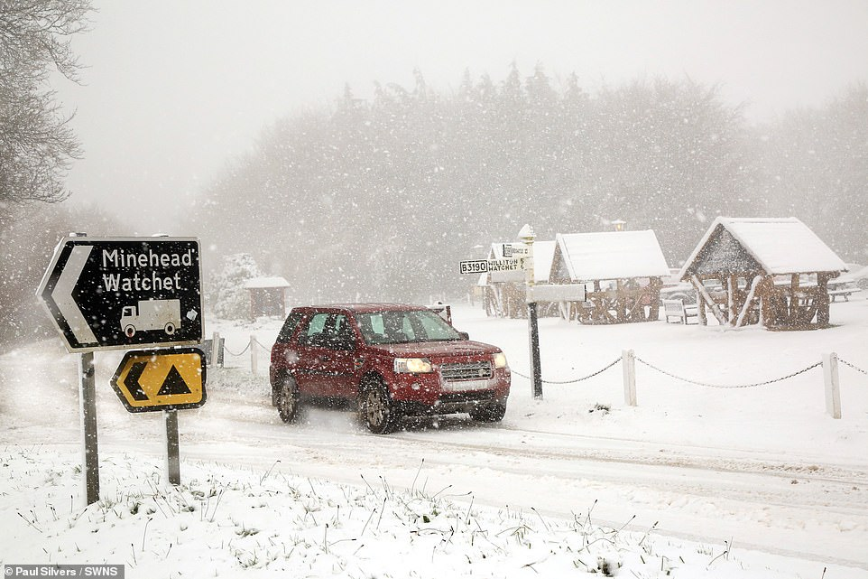 An 'Arctic swell' is expected to brings -9C temperatures to parts of the country tomorrow night. Pictured: Heavy snow made roads in Exmoor impassable on Thursday