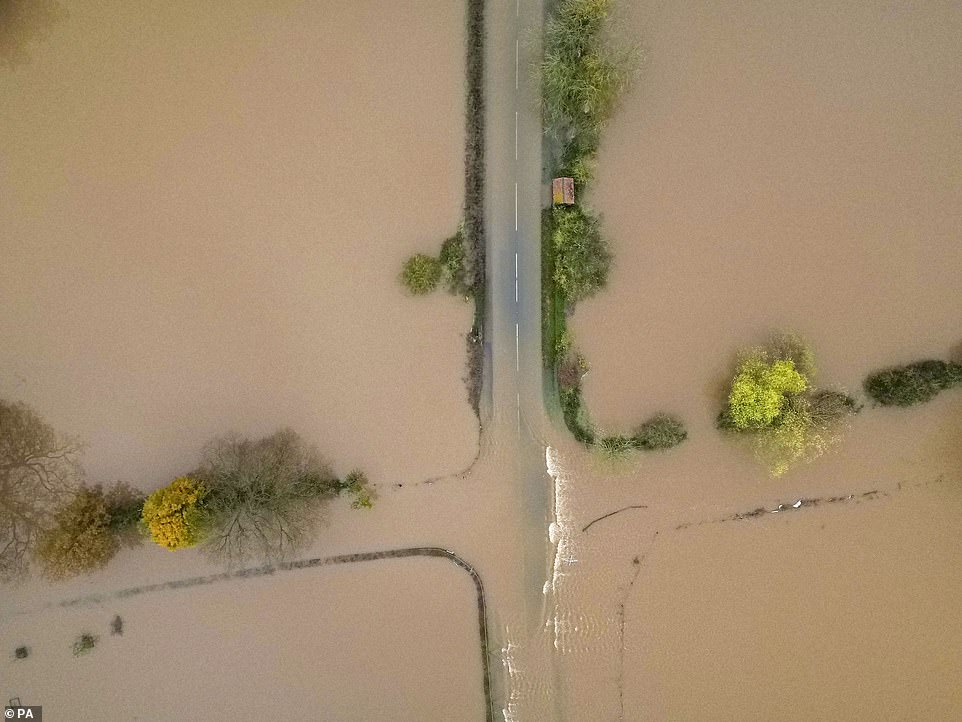 The A4213 in Tirley near Tewkesbury, which is now lying beneath several feet of floodwater, leaving it impassable to transport