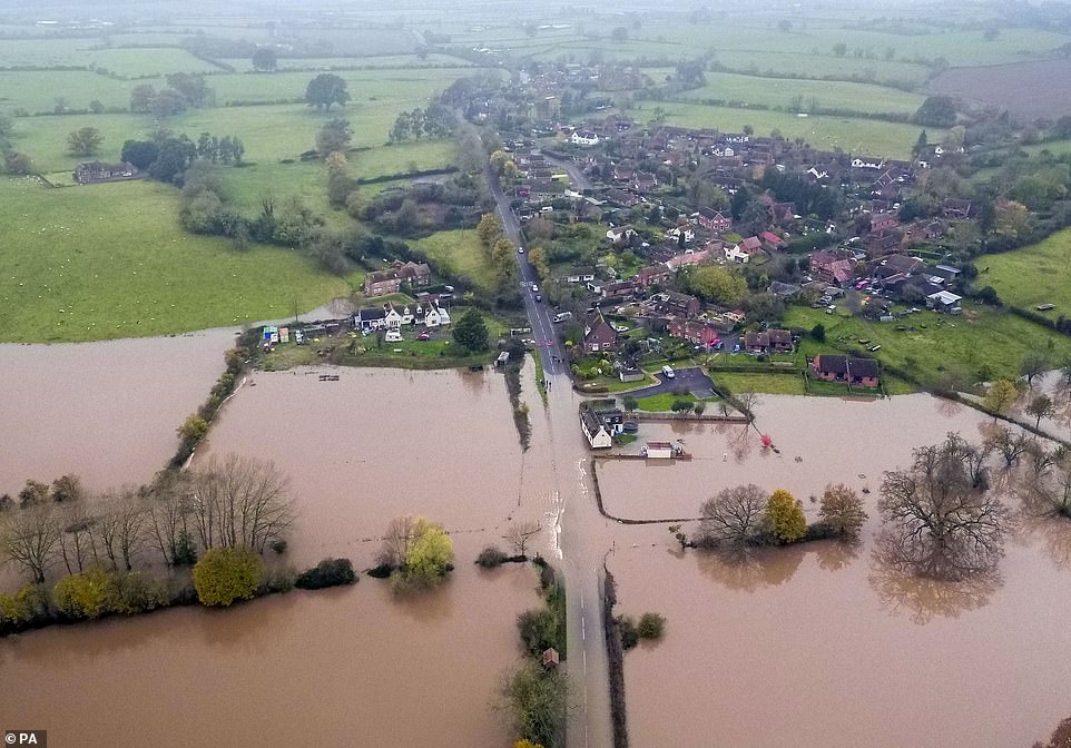 This astonishing image taken near Tewkesbury show how the higher ground has escaped the floodwaters, while the foreground is covered