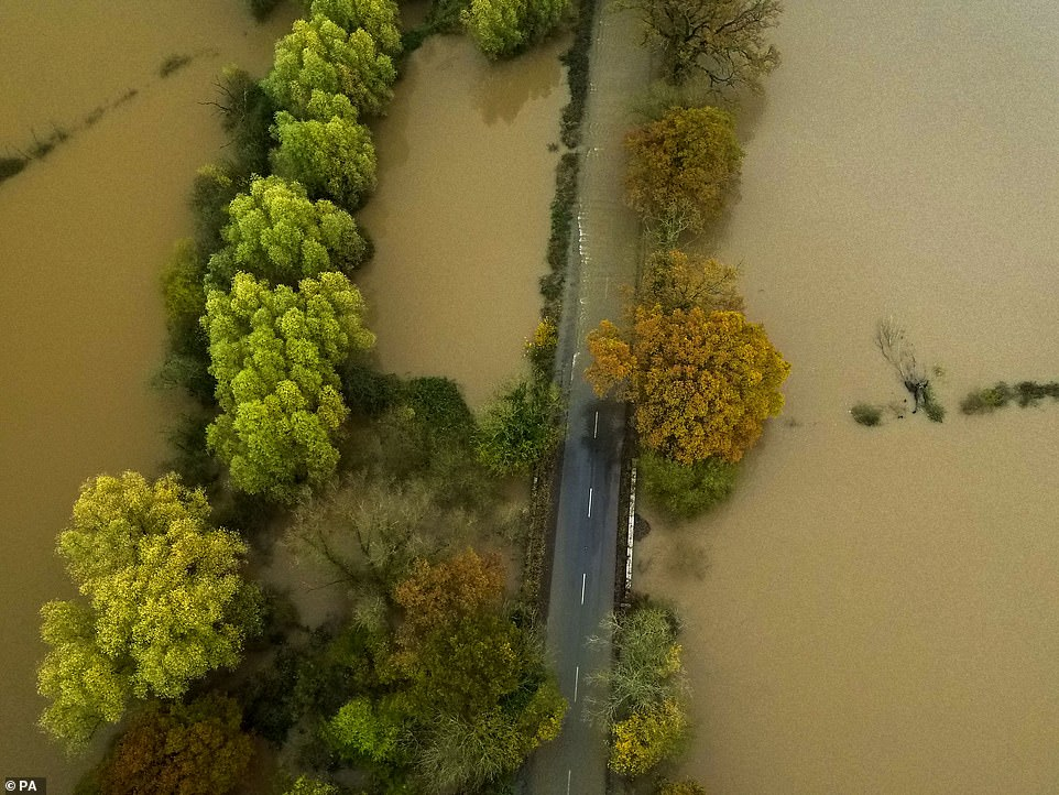 The Met Office said its Sheffield weather station has recorded its wettest ever autumn. Pictured is a flooded road near Tewkesbury
