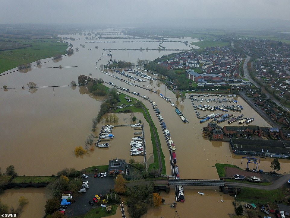 Pictured today: Floods in Tewkesbury, Gloucestershire, where the river Avon and Severn burst their banks.The UK is also set to be hit by more flooding with two inches' of rain expected to fall starting in the west on Tuesday