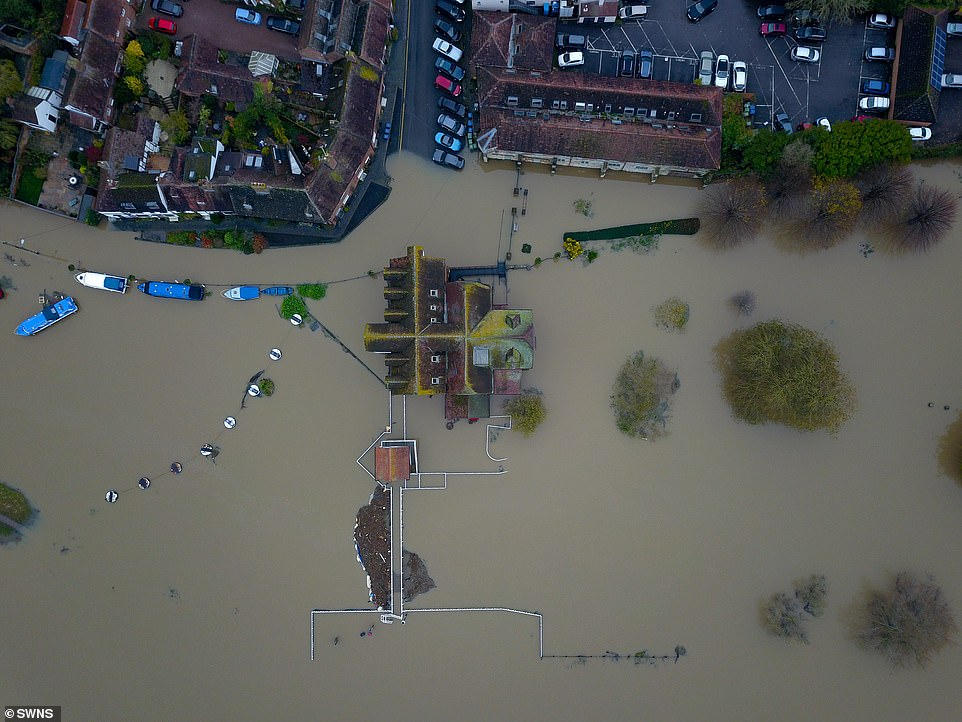 An aerial view of the market town of Tewkesbury in Gloucestershire today where the river Avon and Severn have burst their banks following the last few days of heavy rain