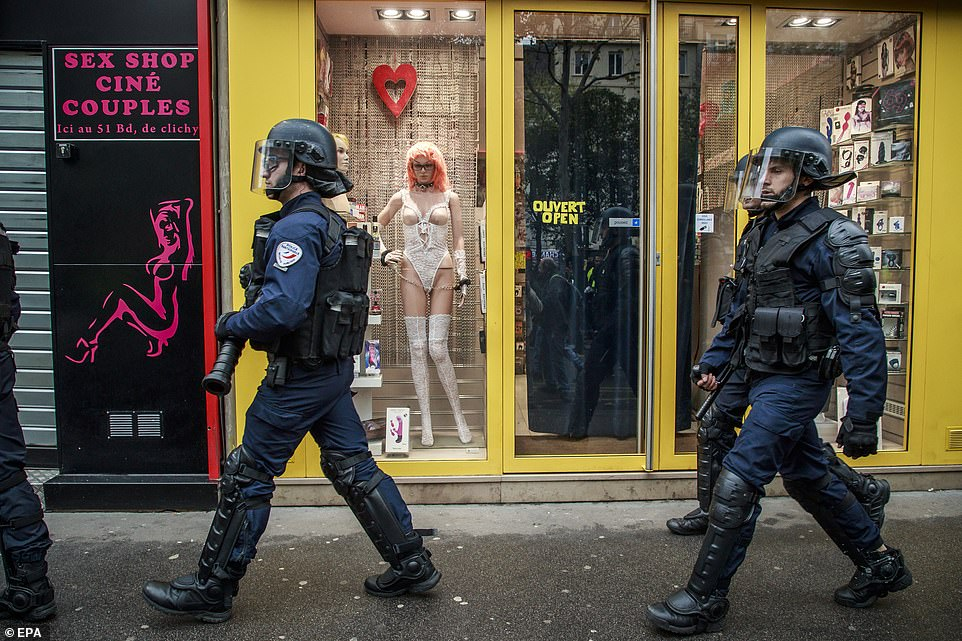 French riot police secure the route surrounding the demonstration in the Pigalle district as 'Gilets Jaunes' prepare to protest today