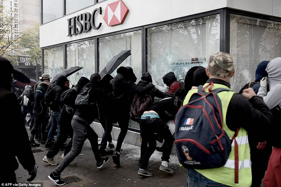 Protesters smashed windows of the British bank, broke open doors, and then lit fires while preventing emergency workers from getting to them