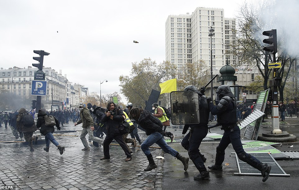 Tear gas and baton charges were used by police in the Place d'Italie, where protesters were preparing to join a march