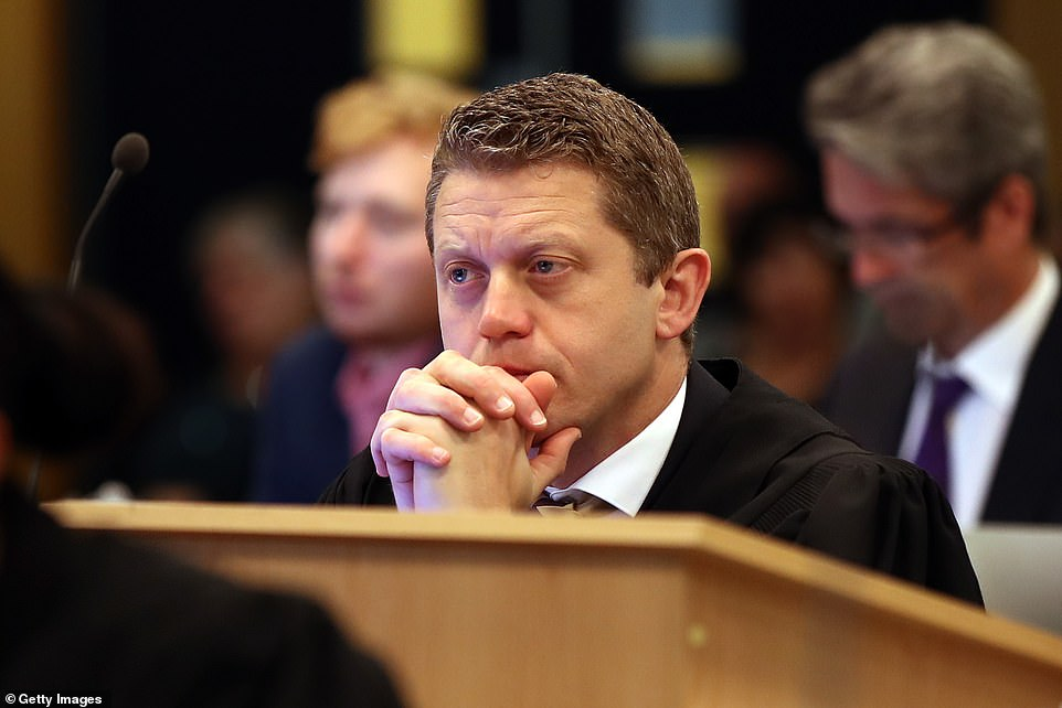 Chief defence lawyer Ian Brookie listens to Justice Simon Moore as he addresses the jury at Auckland High Court