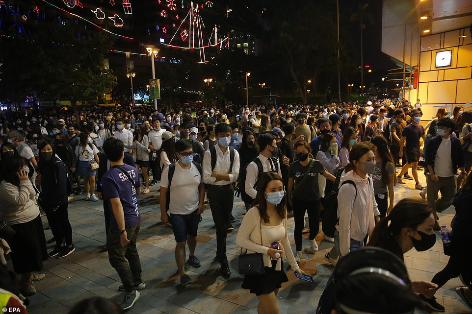 Protesters march towards PolyU, which has become a focal point of the six-month-long Hong Kong pro-democracy protests and the scene of some of the most violent clashes so far