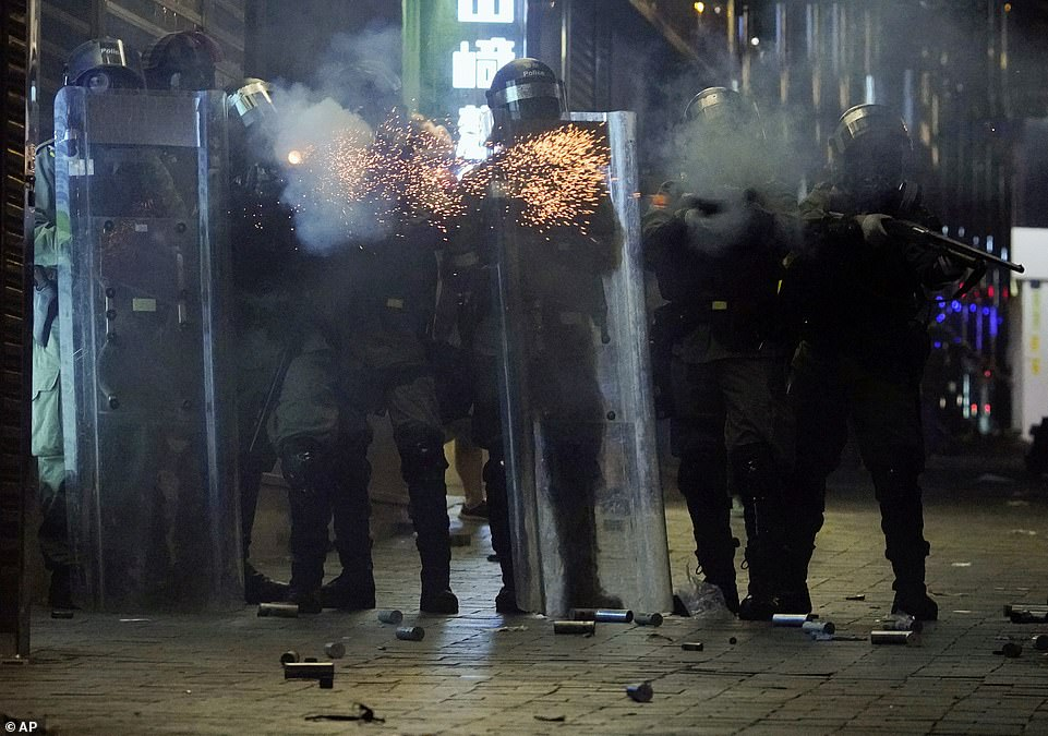 Police fire tear gas to protesters in the Kowloon area of Hong Kong, a short distance from the university, on Monday evening