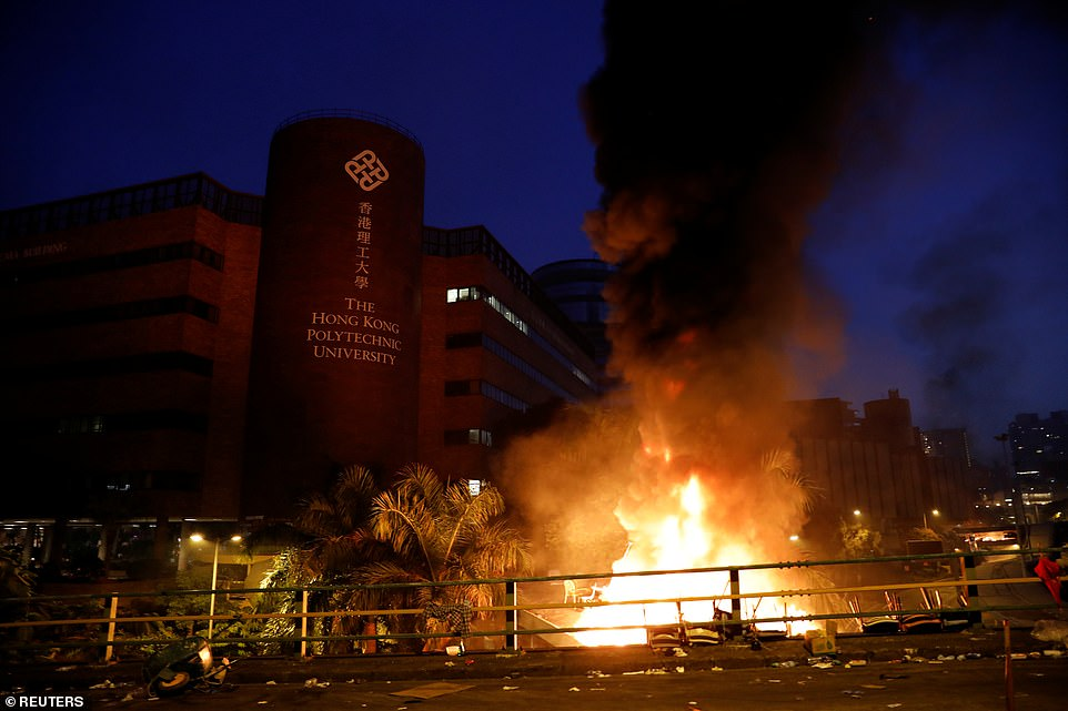 A fire is seen at Hong Kong Polytechnic University (PolyU) during an anti-government protest in Hong Kong. Protesters set fires as police stormed the university