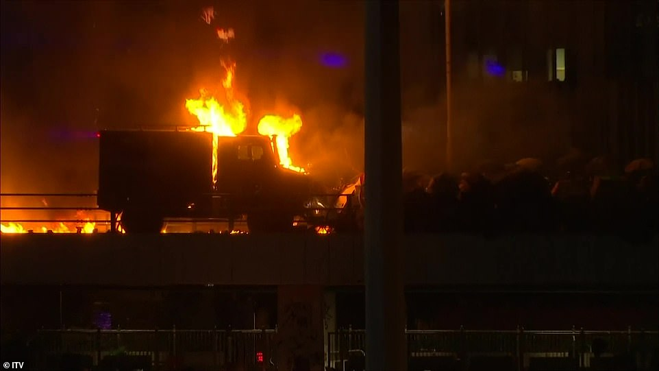 A huge blaze burned along much of a long footbridge that connects a train station to the campus over the approach to the Cross-Harbour Tunnel