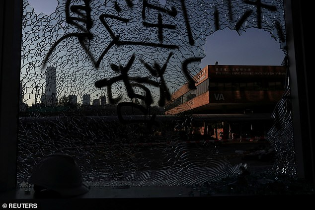 Tang Chun-Keung, head of the Hong Kong Association of the Heads of Secondary Schools, said the holdouts include minors, numbering less than 10, and they are emotionally unstable. Pictured, shattered glass is seen at the Hong Kong Polytechnic University today