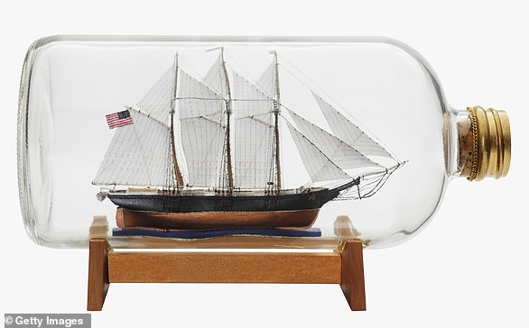 The hull of the boat is made separately, with holes for the masts in the deck, and slipped through the neck of the bottle (stock image)