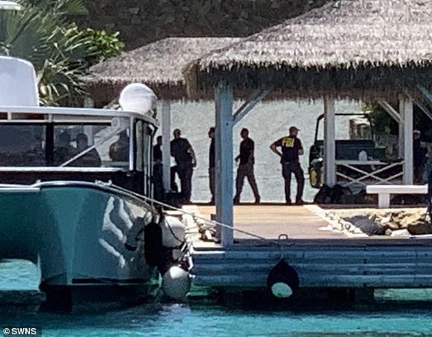Raid: FBI agents were seen raiding Jeffrey Epstein's US Virgin Island Little St James in August - it earned the nickname 'paedo island'