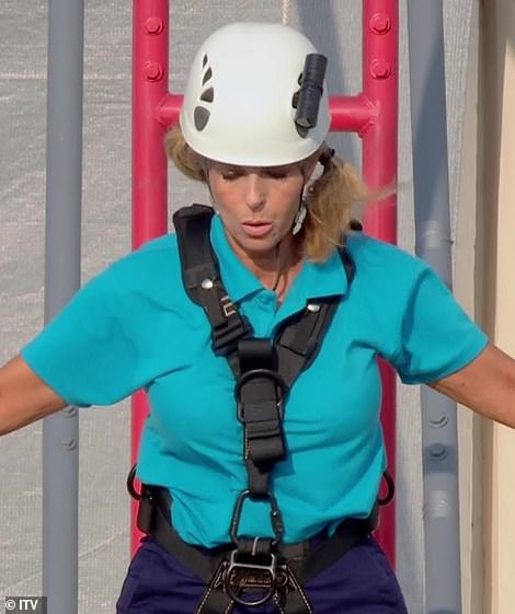 Hysterical: Kate certainly took her time as she slowly walked along the balancing platform with constant encouragement from Andrew