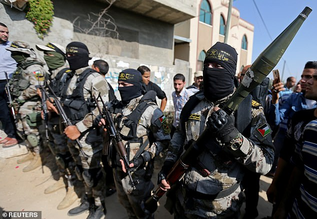 Palestinian Islamic Jihad militants take part in the funeral of their comrade in the southern Gaza Strip November 14, 2019. The Iran-backed militants are the second largest Islamist group in the occupied Gaza strip. The fighting was triggered on Tuesday when Israel killed a top commander of the organisation
