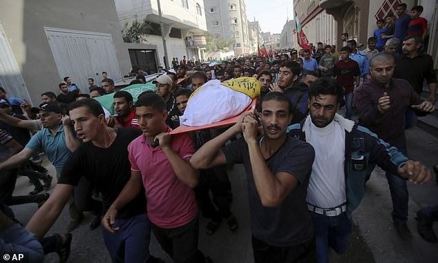 Mourners carry the bodies of Rafat Ayyad and his children, Islam and Amie, who were killed in an Israeli airstrike, during their funeral in Gaza City, Wednesday, Nov. 13, 2019. Reports from today say that 32 Palestinian civilians have been killed during the days of fighting between Islamic Jihad and Israel