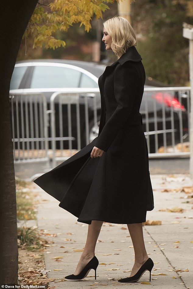 Ladylike look:The first daughter wore a black wool coat over a midi dress