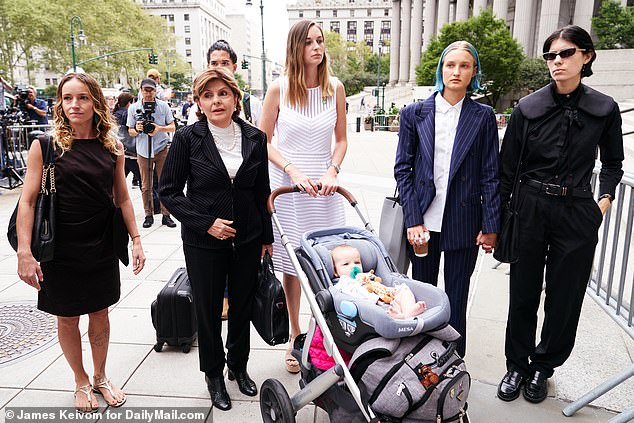 Jane Doe 15 pictured second right with Gloria Allred along with other unidentified women at federal court for a hearing in the Jeffrey Epstein case on August 27