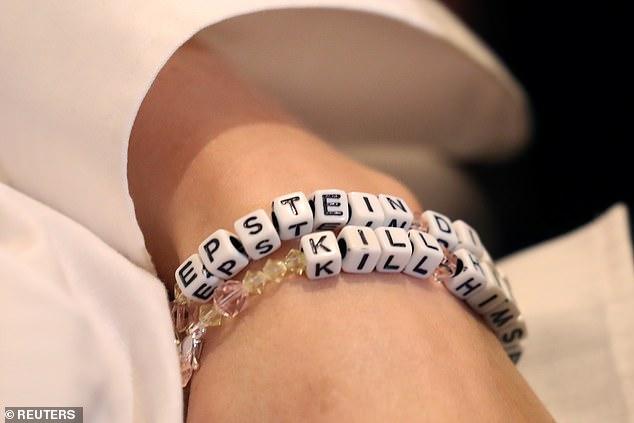 Jane Doe 15 was seen wearing bracelets that spelled out: 'Epstein didn't kill himself'