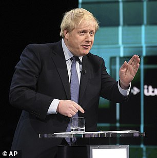 Boris Johnson reacts during the election head-to-head debate live on TV, in Salford, Manchester