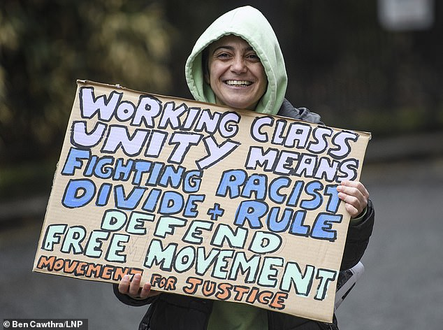 One pro-immigration campaigner held a sign outside Labour's manifesto meeting that said: 'Working class unity means fighting racist divide and rule. Defend free movement. Movement for justice'