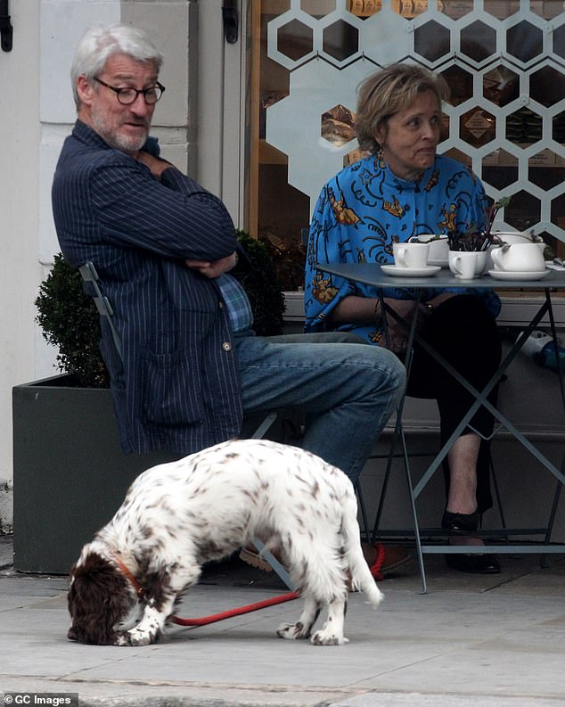 Jeremy Paxman seen having coffee with a friend in London, in September 2017, while keeping a close eye on Derek