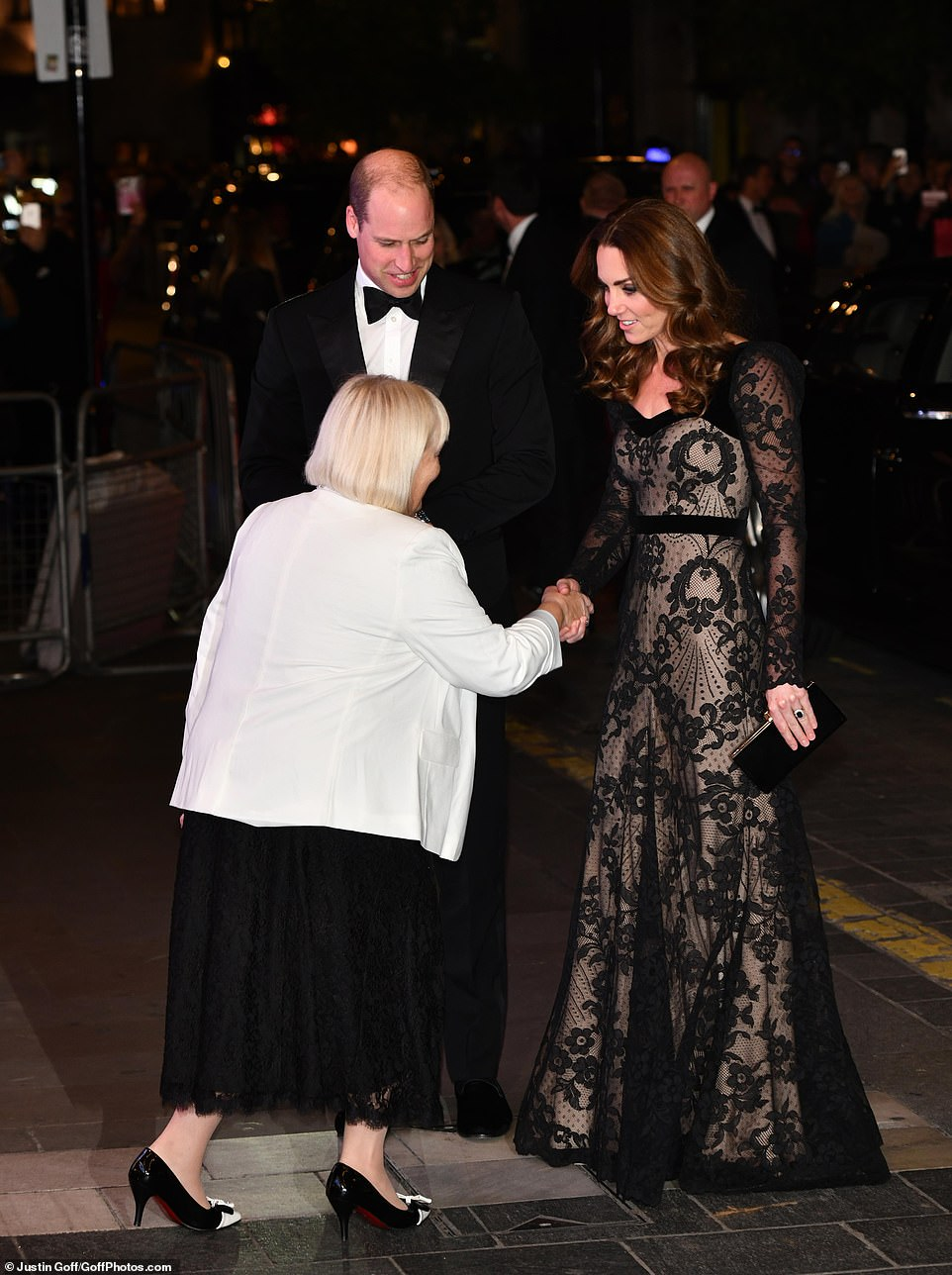 The event is in aid of the Royal Variety Charity, formally known as The Entertainment Artistes' Benevolent Fund, of which The Queen is Patron. Pictured: Kate shakes hands with an official at the event