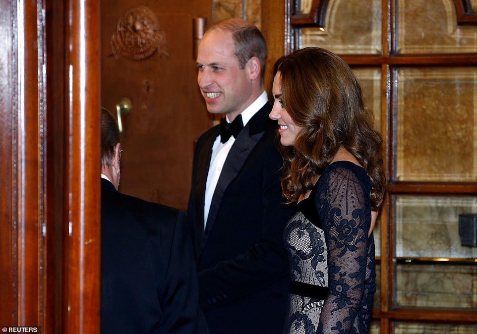 Prince William, Duke of Cambridge, and Catherine, Duchess of Cambridge, pictured entering the theatre for tonight's performance