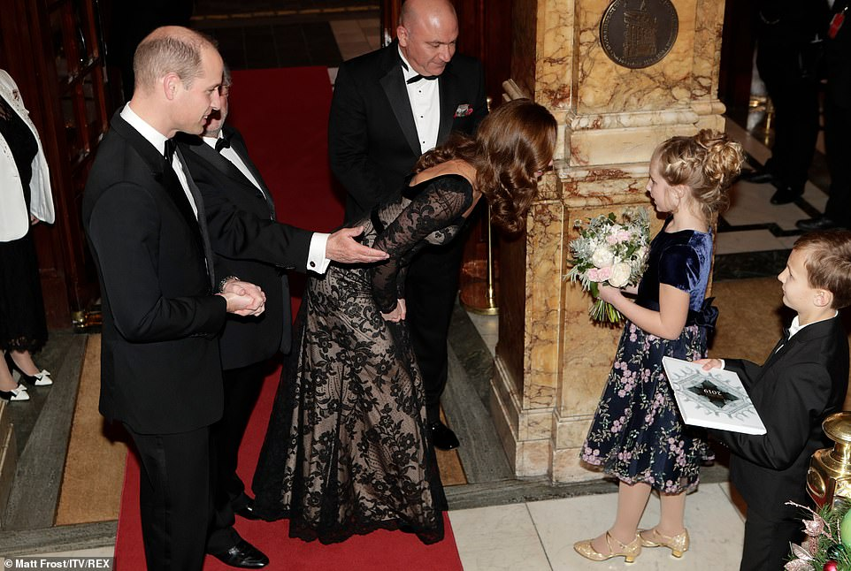 Kate was presented with a posy of flowers picked from the garden of the Royal Variety Charity's residential home in west London, Brinsworth House, called 'Frosty Winter Garden' by Lydia Jones, 10