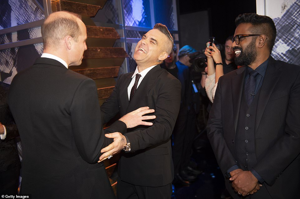 Prince William, Duke of Cambridge and Catherine, Duchess of Cambridge attend the Royal Variety Performance at Palladium Theatre where they met with pop singer Robbie Williams and also Romesh Ranganathan