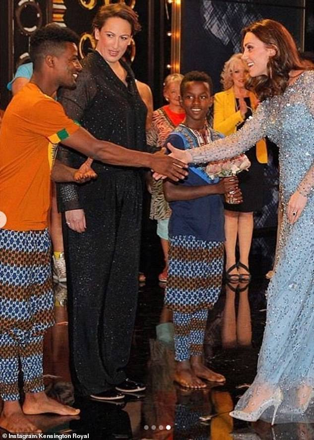 Kate, who dinned a floor-length powder blue Jenny Packham dress could be seen shaking hands with performers after the show in the London Palladium theatre in 2017