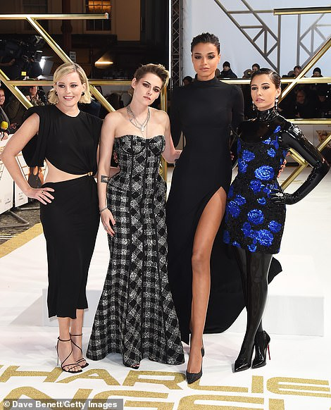 Charlie's Angels: Naomi styled her cropped brunette locks into a gelled back hairdo (pictured with her co-stars Kristen, Ella and Elizabeth)