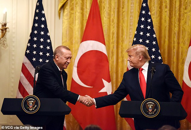 Turkish President Recep Tayyip Erdogan shaking hands with President Donald Trump during a joint press conference following their meeting at the White House. It was announced that the US would take back its citizen left stuck between Turkey and Greece